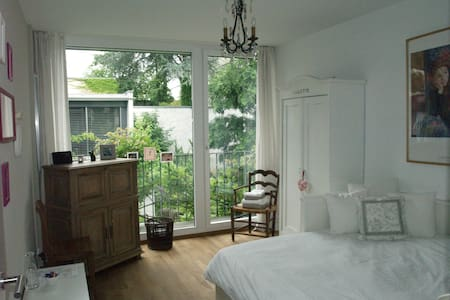 Charming bedroom + modern bathroom  - House