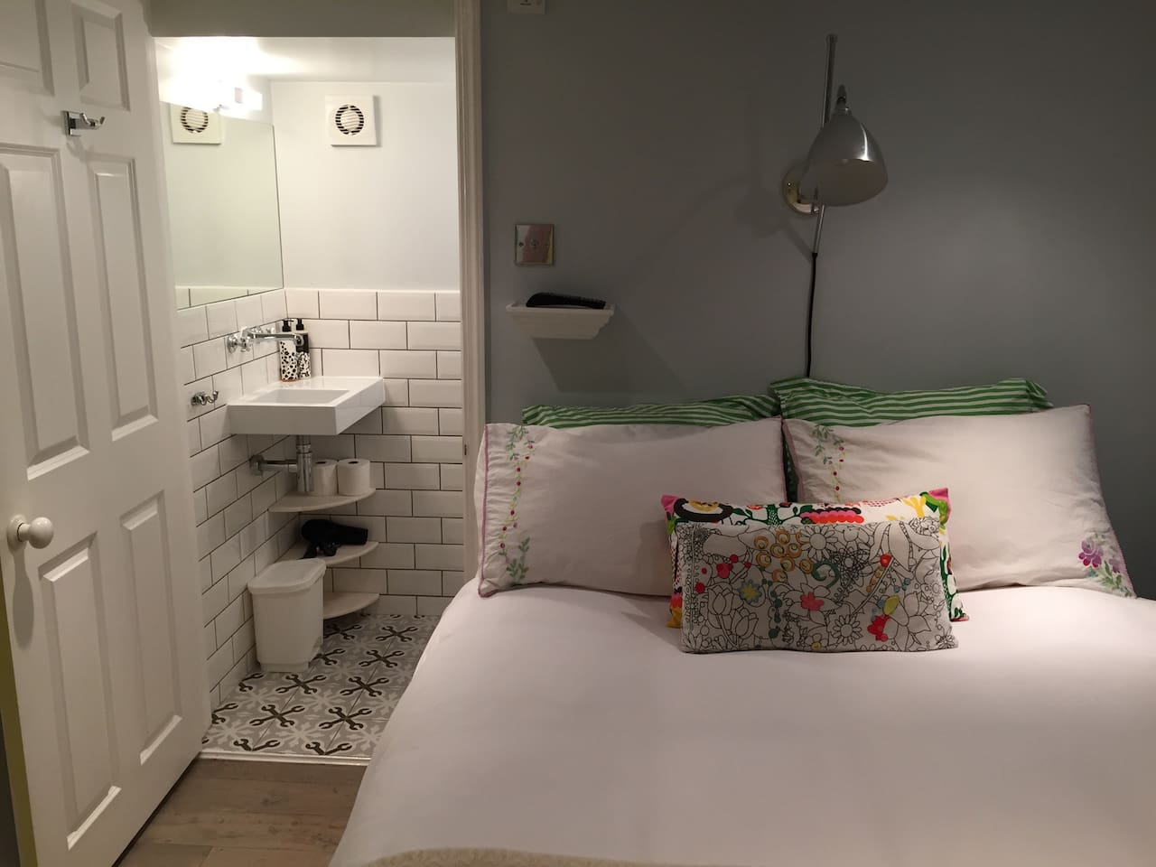 Double bed with en suite washbasin and loo.