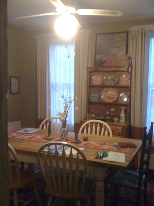 The breakfast room with seating for six guests.
