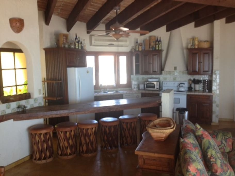 Another photo of the kitchen and bar stools in the kitchen area.  Kitchen has oven, microwave, coffee maker, tea pot, blender, toaster, all new plates, cups and new cooking ware being taken down all the time.  Please don't take home the Tupperware. : )