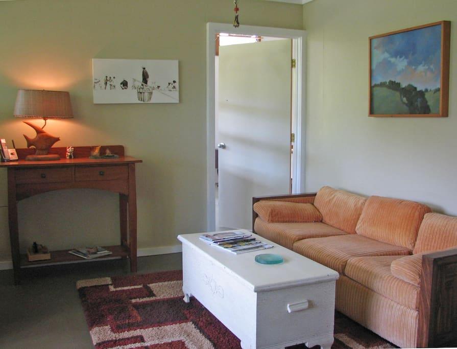 living room with door into art studio