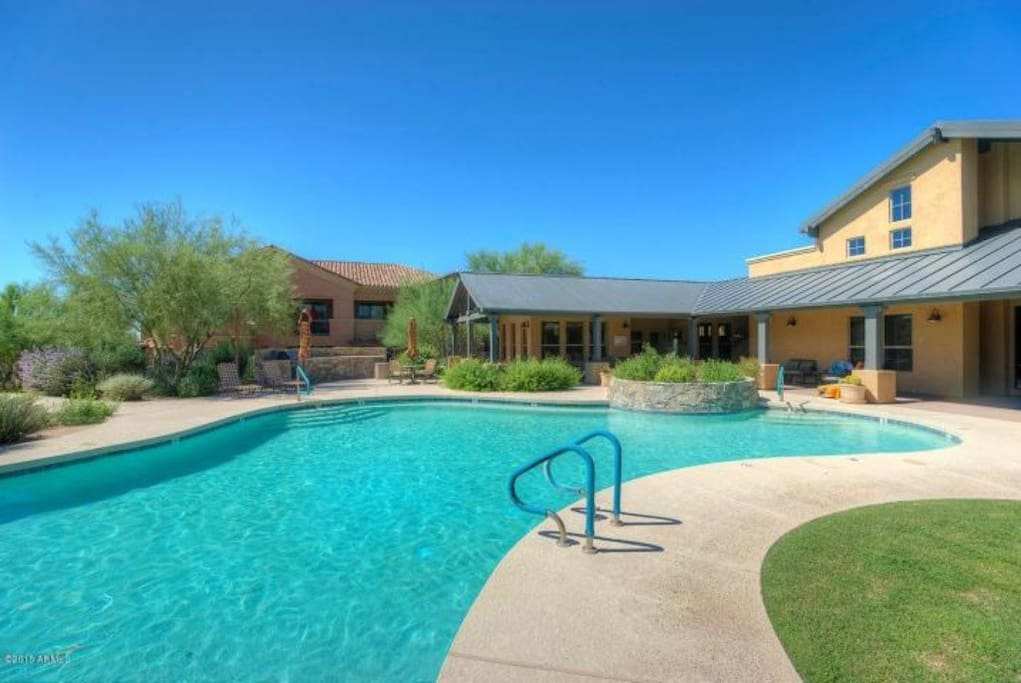 Heated jacuzzi and pool. Lots of comfortable seating in the sun and shade, and grills for cooking. All steps away from the condo.