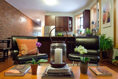**Brand new listing** Please check my profile for reviews! A spacious newly renovated apartment outfitted with modern luxuries. Exposed brick, elegant furniture, lush greenery & lavish art await you. This urban oasis is sure to heighten your stay