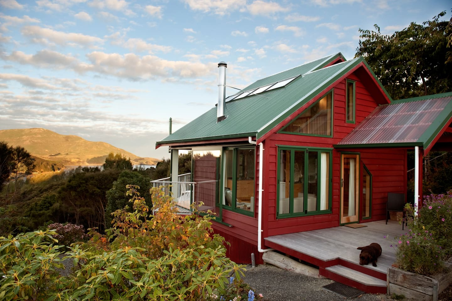 Hereweka Garden Retreat set in the secluded Hereweka Garden. Magnificent views from every window of garden, bush and water.