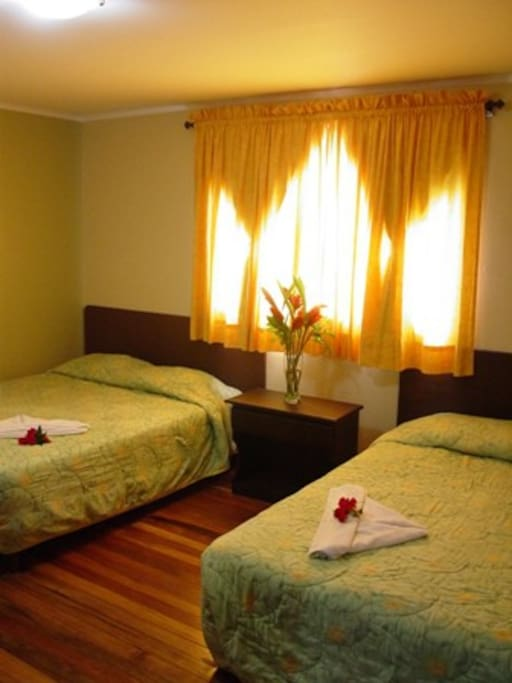 Quadruple Room, Outdoor view, 2 Queen Beds, Fan, free wi-fi access and Cable TV. Breakfast & taxes are included