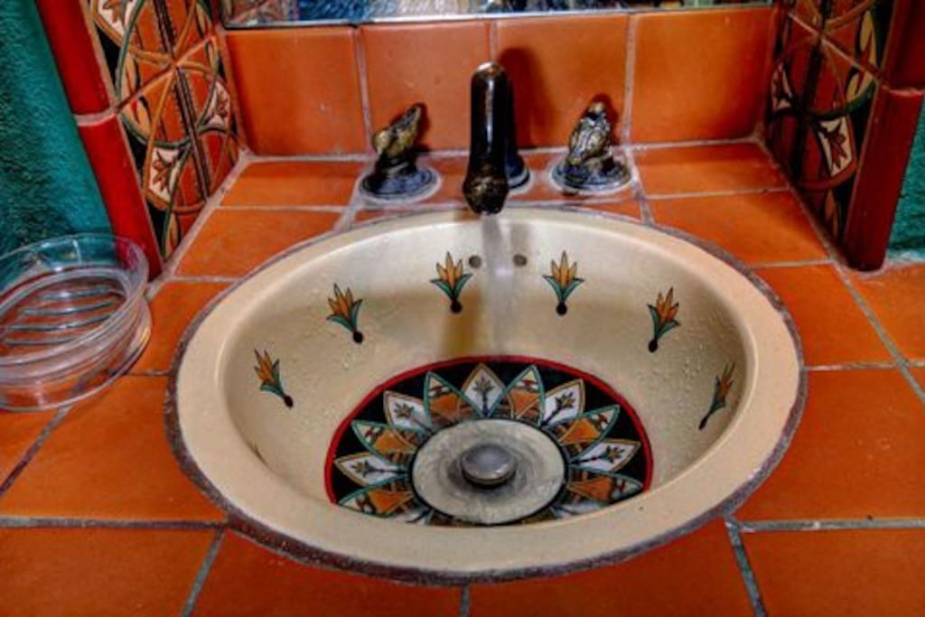 Mexican accents throughout the bathroom, like the pretty sink