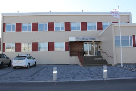 Hotel Tangi Free WiFi, Hotel Tangi is in the center of Vopnafjörður. Accommodation.Resturant and bar. The hotel has a terrace and sun terrace, and guests can enjoy a drink at the bar. Some room have a flat-screen TV.big screen to watch Sport.