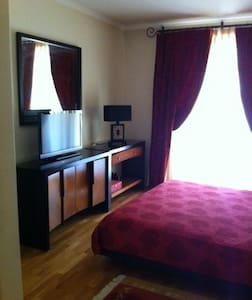 Quarto em suite com varanda/piscina - Lägenhet