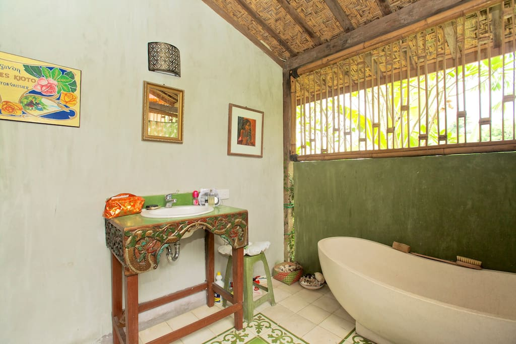 Private bathroom, but you feel a part of the tropical garden outside.