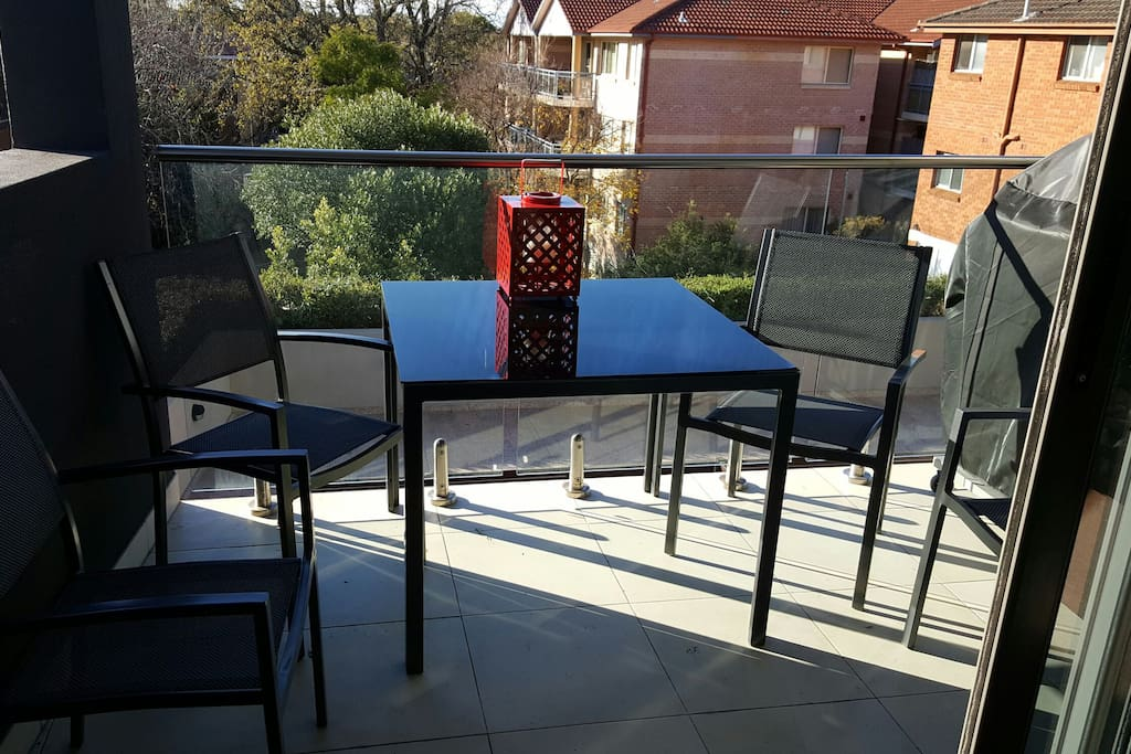 Balcony with outdoor setting BBQ and Heater.