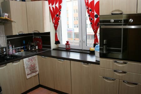 Apartment (38m2) just in the centre of Gdynia. A single spacious (22m2) room, with two double beds. One raised  bed, and