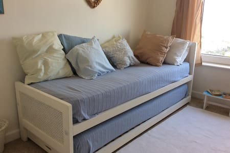 Beautiful 2 single beds bedroom in a family home with shared bathroom and probably the best views in St Ives. Use of garden and allocated parking space.