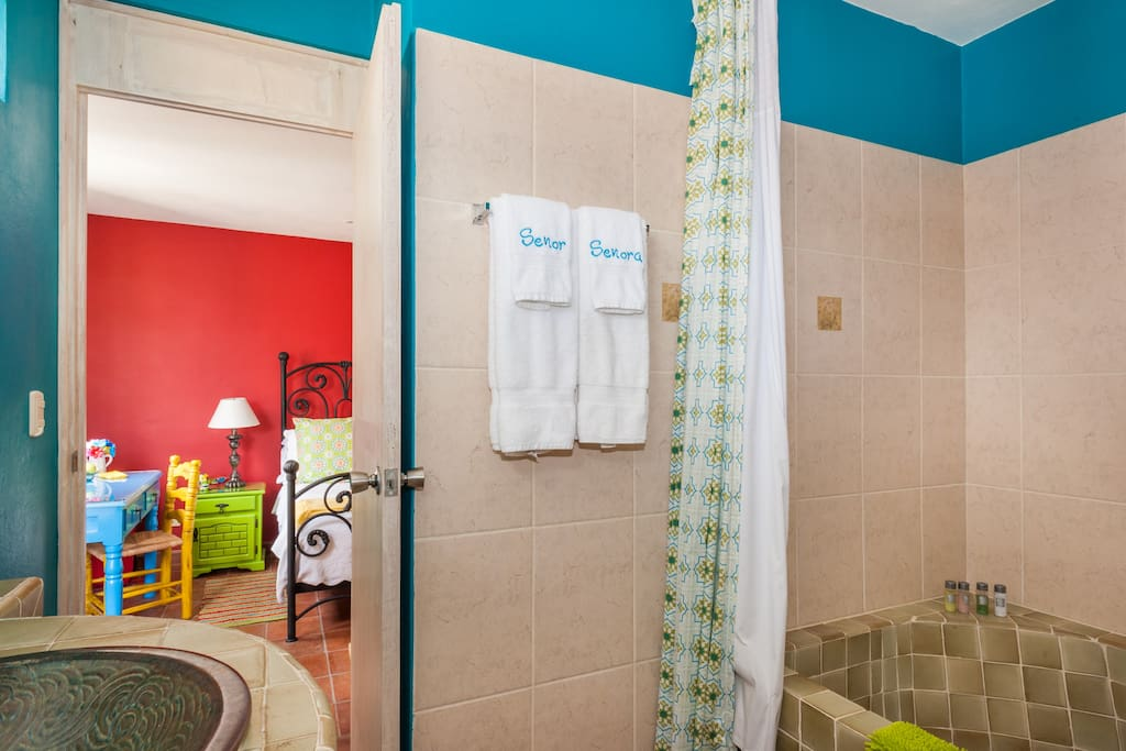 Shower and bathtub with soft, plush towels.  After you leave the used hand soaps are donated to the Santa Julia Girls' Orphanage.