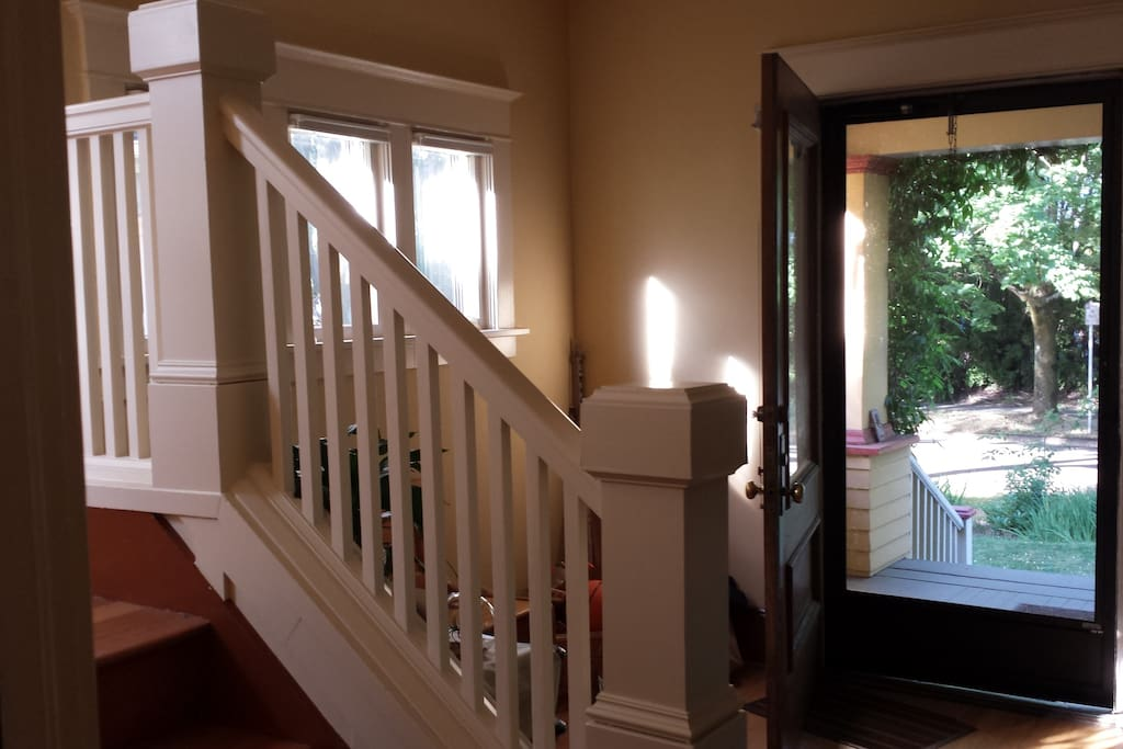 New historic bannister and view from foyer to front porch.