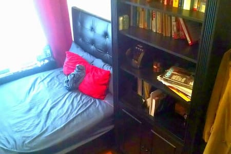 Full size bed in a small bedroom with office including a wired desktop and laser printer in the room. Located off Fresh Pond Road in Ridgewood. This room is ideal for a night stay over for 2 person. Access to the kitchen and a fully stocked bathroom.