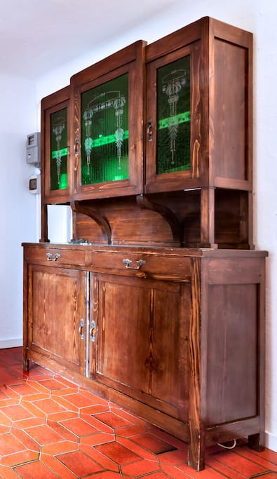 late 1800 kitchen pantry with amazing decorated green glasses, same style as the building the flat is in
