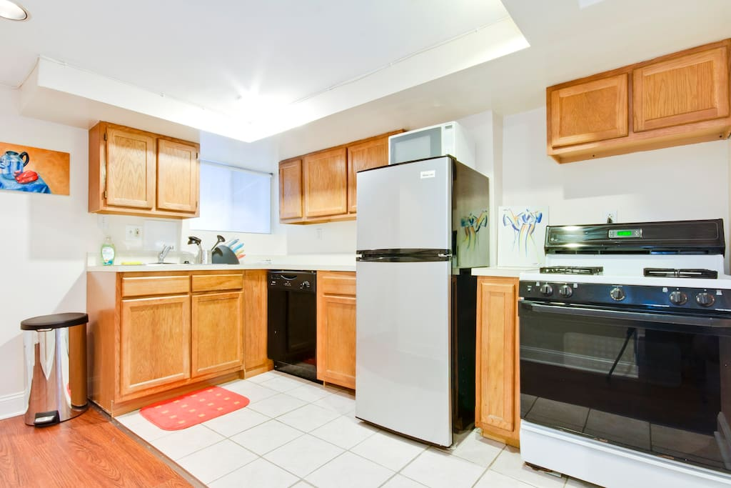 Full kitchen with dishwasher, refrigerator, microwave oven, toaster, gas stove/oven and everything you need to cook and eat and drink; i.e. pots and pan, plates, glasses, wine glasses, utensils, etc.