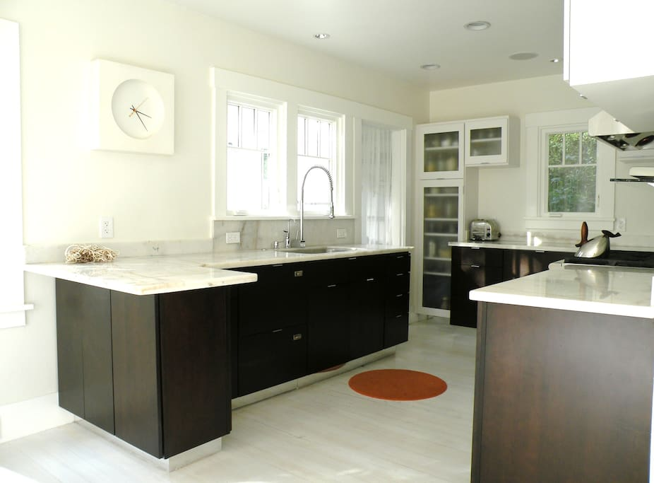 Kitchen with in-cabinet dish-washer, refrigerators and freezers