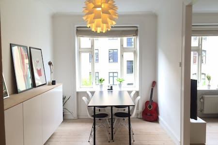 """Spacious apartment full of natural light in the quiet but central location of Frederiksberg - """"The Green City"""" of Copenhagen. About 2 kilometers (1.24 miles) from Copenhagen centre, close to the subway in an area full of restaurants and bars."""