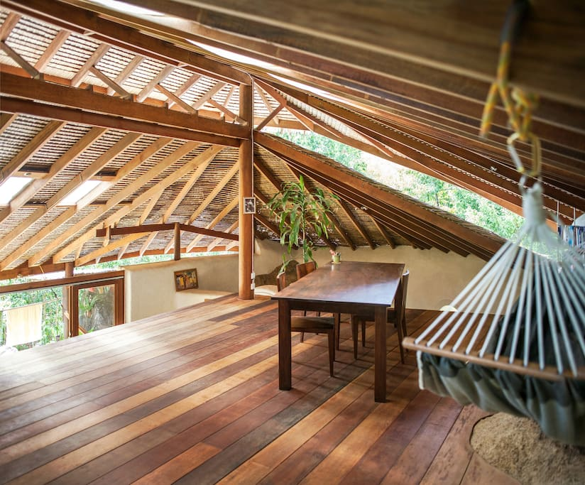 20sqm Loft with hammock, book shelves and a large teak table