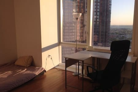 Spacious, light filled room in a luxury building. - Apartment