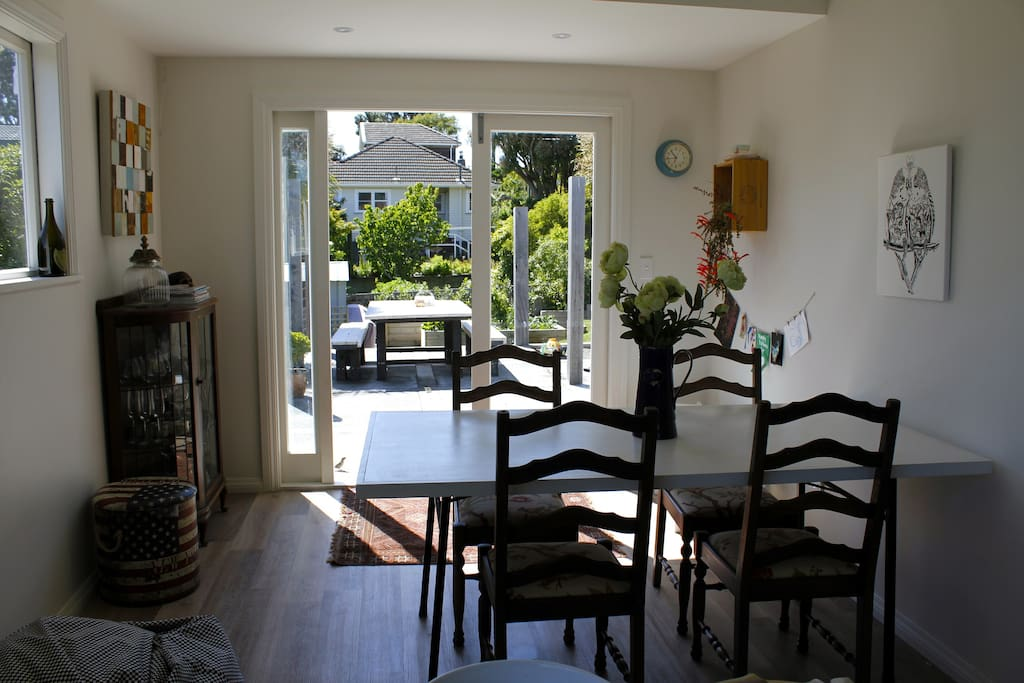 Dining room with double doors to outdoor courtyard