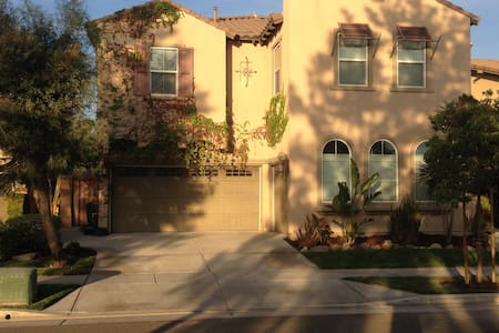 Our spacious home is luxurious and relaxing.  There is ample room for a family or large group.  We are near all the Southern CA attractions while also feeling enough removed that you can enjoy peace and quiet.    The Ontario airport (much nicer experience than LAX) is nearby.