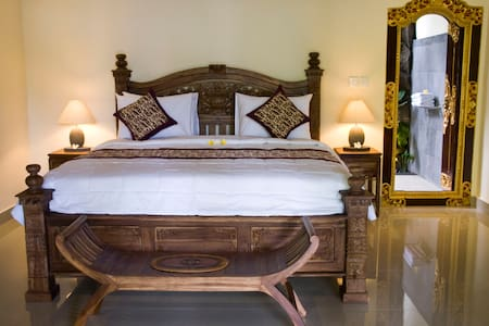 Stay in a local Balinese village, with our local family. Experience a true Bali life during your holiday/travel to Bali.  Only a short car ride to Ubud, and 15 min walking distance to the heart of the action.   Breakfast, A/C, hot shower, king bed.