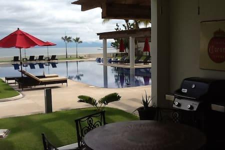 Luxury 2 bedroom ground floor condo Beachfront - Condominium