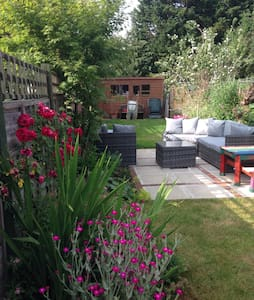 A lovely little terraced house with a gorgeous relaxing garden.  You will have a private room with a TV and have access to a bathroom, shower, living room, kitchen.