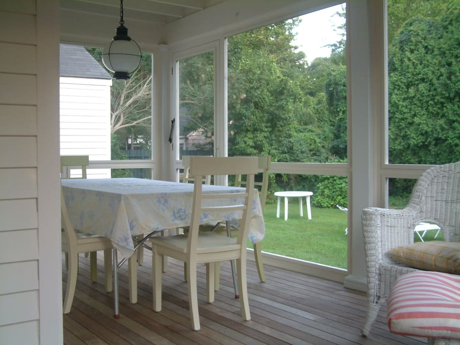 Relax and unwind on our beautiful screened in porch