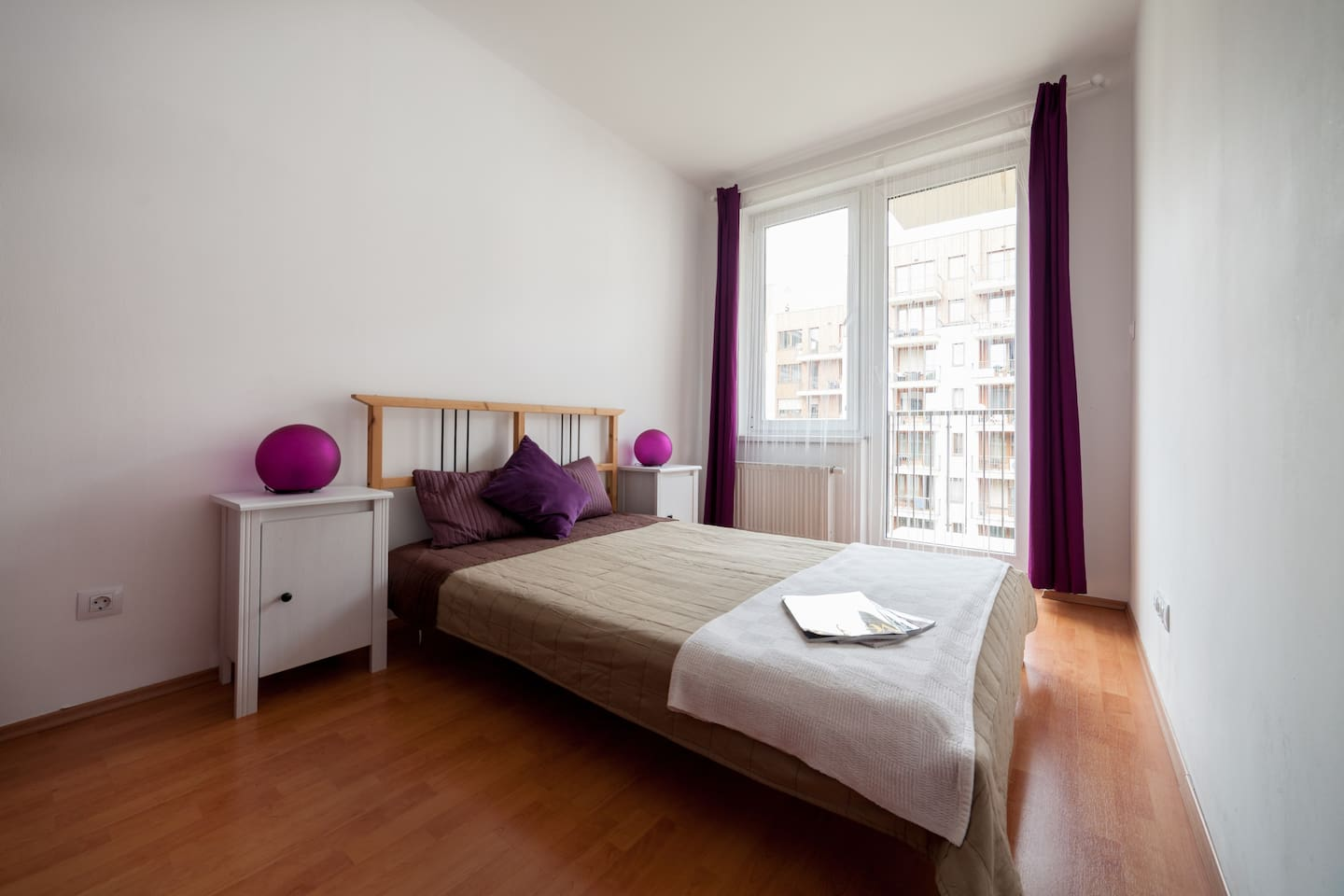 Spacious double bedroom with access to the balcony