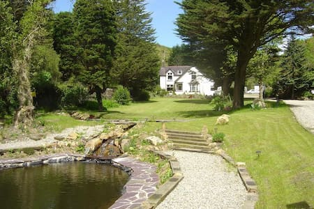 Beautiful Secluded Home with Extensive Grounds - House