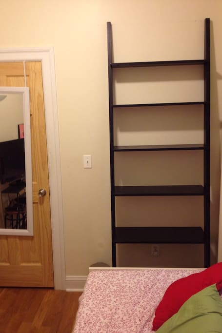 Your bookshelf to put up any personal items you like to travel (website hidden). photo of family or pets, makeup etc.