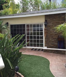 240 sq ft.  Includes bathroom with shower, closet and mini- refrigerator.  2.3 miles -beach.  4.7 miles -LAX. Located within walking distance to restaurants & mall. Vaulted ceiling, fan & marble floors. Come and go as you please with private space!
