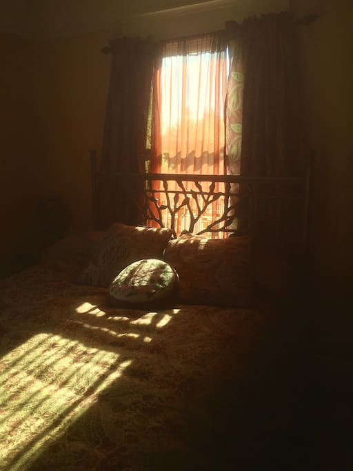 Sweet sunshiny spot for a nap and/or room darkening curtains as needed.