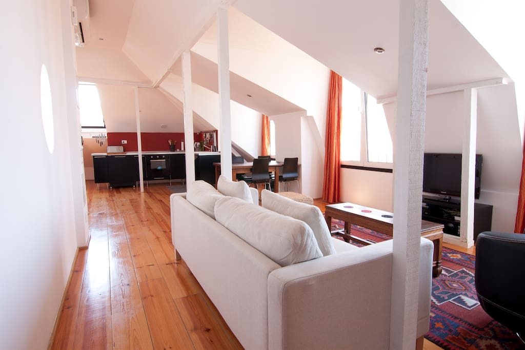 the living room connects seamlessly with the dining room and kitchen