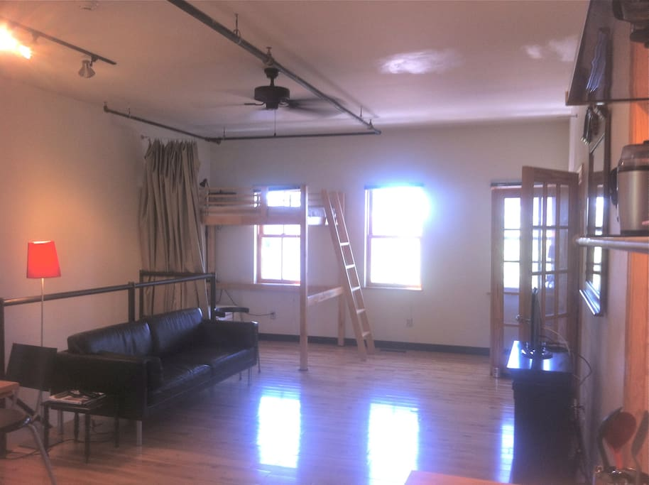 Upper Loft: Living area with second sleeping area (loft bed/curtain room divider).