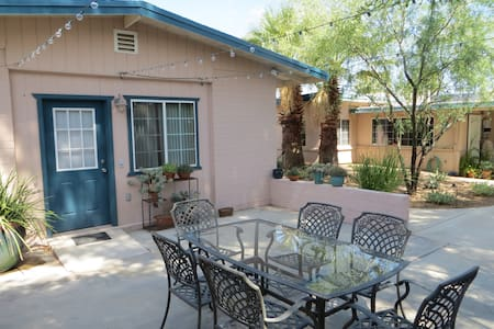 Charming guesthouse central Tucson.  Recently remodeled. Sleeps up to 4.  Grocery stores, malls, golf, tennis, shops, restaurants, TMC and St. Joseph hospitals all within 1  1/2 miles.  3 miles to U of A.  On direct bus line to U of A and downtown.