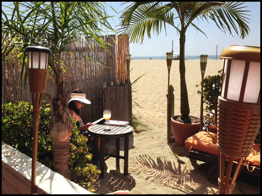 Step right onto the sand from our beach front patio.