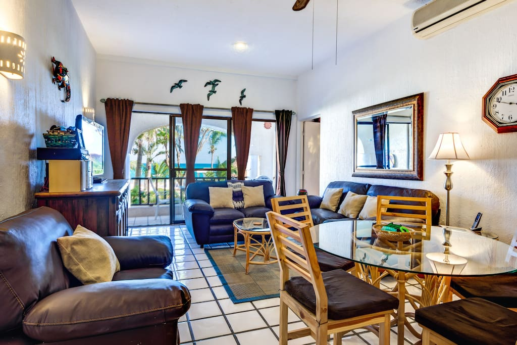 Comfortable living and dining area overlooks the ocean