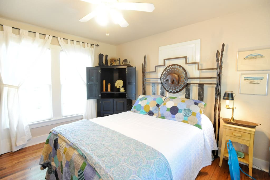 This QUEEN BEDROOM has a hand-forged headboard.  New linens, makeup table with mirror, dresser.