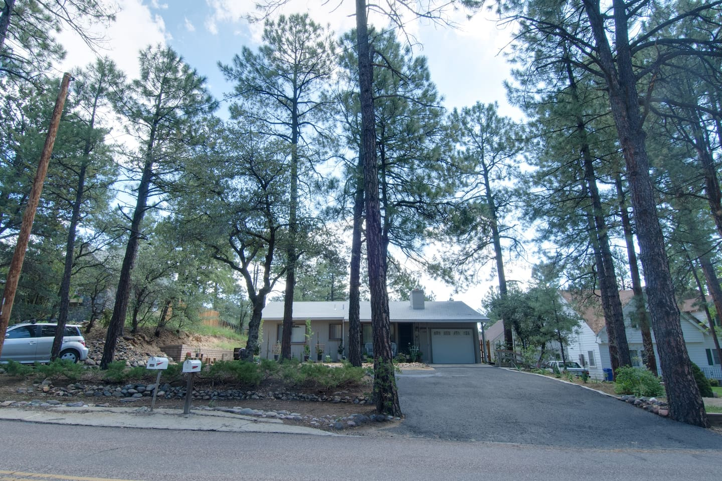 Front view of main house. We are in the tall trees of downtown Prescott.
