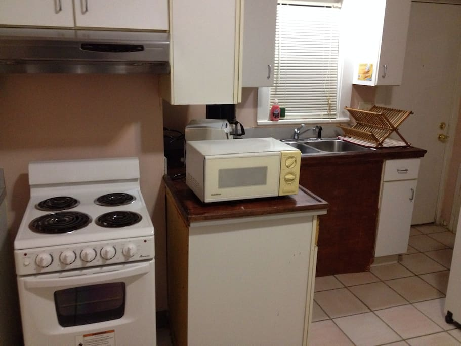 Small stove, oven, microwave, toaster and coffee maker for your convenience.