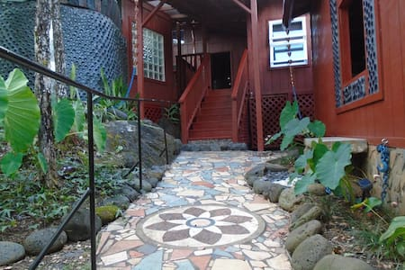 Stay in a timeless art house infused with many multimedia up cycled art installations .  The house also has manicured gardens,  and off-grid solar/wind power, making this the perfect self-sufficient hideaway. Inspiration awaits in old Hawaii.