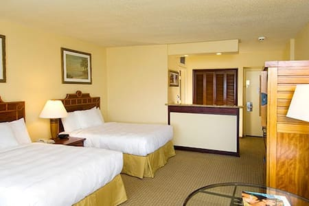 These rooms are located to the rear of the resort, and therefore offer views of the tropical grounds or the West Hawaii Mountains.  General Room Amenities Air Conditioning Alarm Clock Iron and Ironing Board King size or two double beds Patio Safe