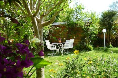 Appartamento con giardino e portico - Lejlighed