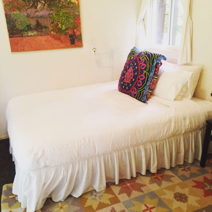 Very comfortable bed with down comforter and pillows, high thread count sheets