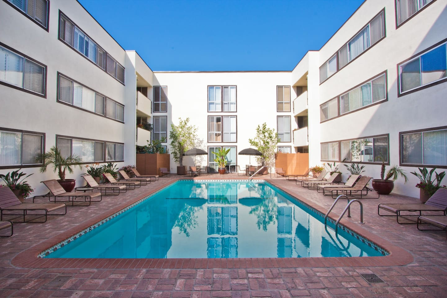 Overlooking pool and private patio-- unit is on the second floor