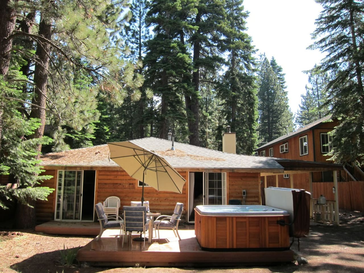 backyard with hot tub, deck, horseshoes